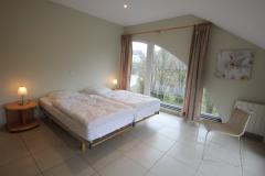 Acht slaapkamers met twee éénpersoonsbedden