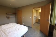 Eén van de acht slaapkamers met twee éénpersoonsbedden